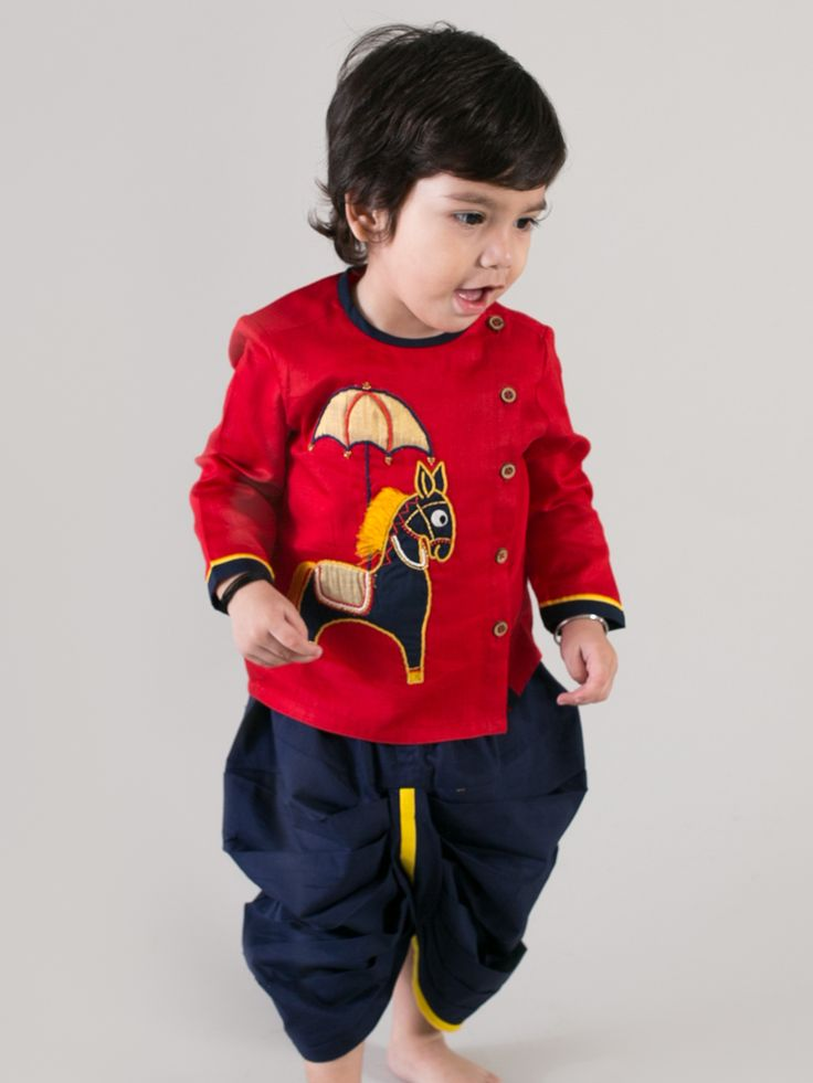 What spells festivity and royalty as good as fully decked up and colourful Indian horse from the dreamy miniature paintings of Rajasthan. Appliqued and hand embroidered on a richly hued red kurta and paired with a well-co-ordinated navy blue dhoti it is the most dapper thing to pull off for all occasions. Isn?t it perfect for your little baby boy! ? 2 Pc Set, Kurta and Dhoti ? 100% Cotton ? Hand embroidered ? Coconut Shell Buttons ? Gentle Hand wash. Dark colours separately.