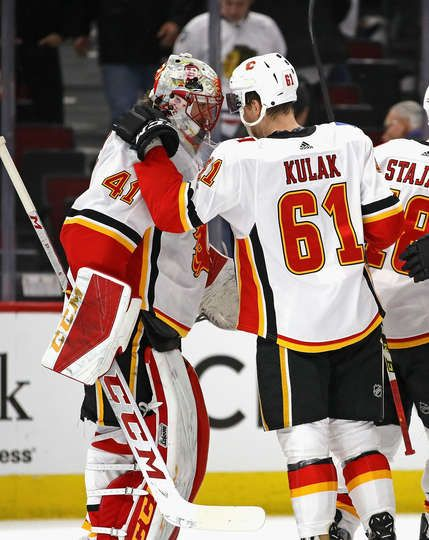 CHICAGO, IL - FEBRUARY 06: Mike Smith #41 of the Calgary Flames is congratulated by Brett Kulak #61 after a win over the Chicago Blackhawks at the United Center on February 6 2018 in Chicago, Illinois. The Flames defeated the Blackhawks 3-2. (Photo by Jonathan Daniel/Getty Images)