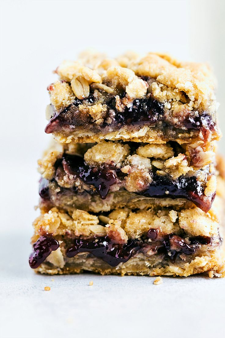 Incredibly simple and delicious oatmeal cookie jam bars. These bars come together in less than 30 minutes and only require 6 ingredients!