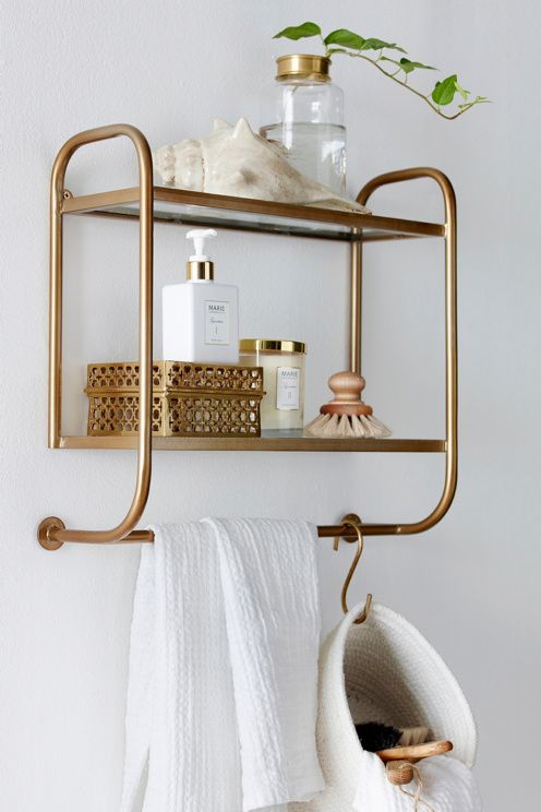 bathroom goodies on a stunning brass shelf