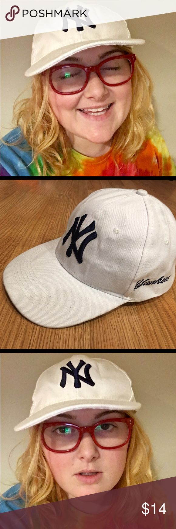 New York Yankees white baseball cap New York Yankees white baseball cap with navy logo. Adjustable Velcro closure in the back. Never been worn. Super comfy, cute & hipster Accessories Hats