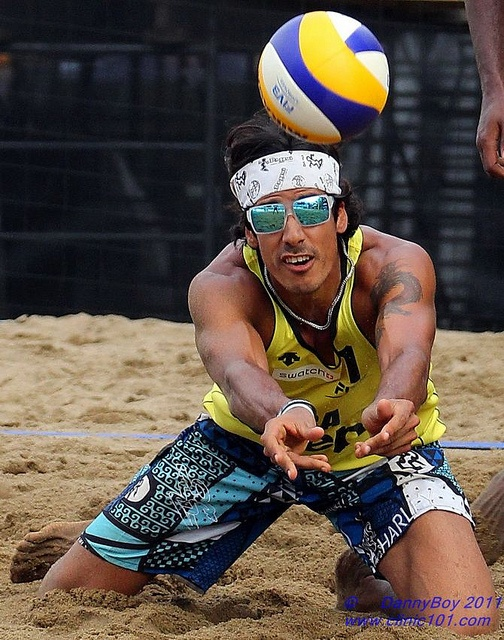 Harley Marques Silva from Brazil Digs it. FIVB Beach volleyball in Quebec, Canada.