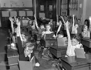 1950s classroom-kids were better behaved because they knew they'd get in trouble- at home and at school. They had more respect for teachers(and teachers were more respectable), and children were taught manners!