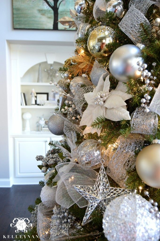 Elegant White Gold and Silver Christmas Tree Closeup- Filled with flowers, ribbon, stars, and ball ornaments