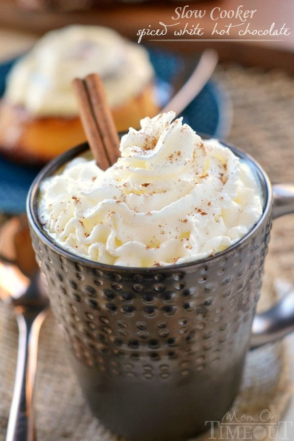 Slow Cooker Spiced White Hot Chocolate is perfect for the cool fall and winter days ahead. Whip up this sweet treat for your friends at your next girls' movie night!