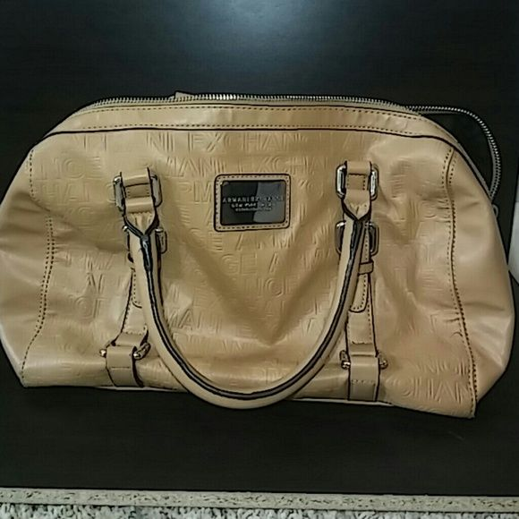 Beautiful Armani Exchange Tote. Beige leather Very nice Armani Exchange beige leather tote. Black cloth interior. Armani Exchange Bags Totes