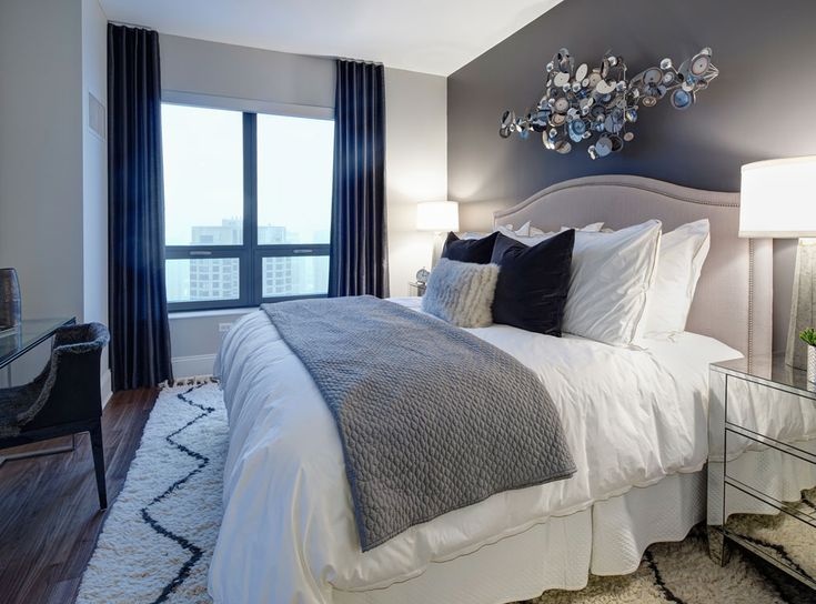 Model bedroom at AMLI River North, a luxury apartment community in Chicago.