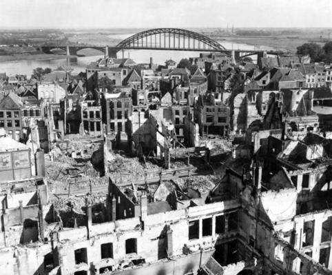 "Nijmegen, Netherlands, in the aftermath of the ""Market Garden"" operation. Nijmegen was the scene of fierce German resistance to the advance of the British armoured column, organised to a great extent by ""scratch"" Heer and Waffen SS units on the spot. The resulting delay in the capture of the Nijmegen road bridge was a significant factor in the failure of the Market Garden operation."