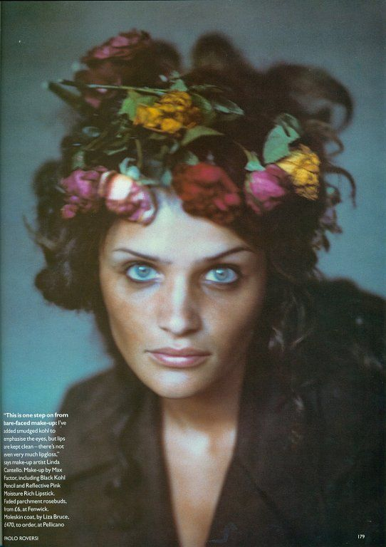 Helena Christensen with flowers in her hair by Paolo Roversi. This spring, put a ton of big flowers on my head.