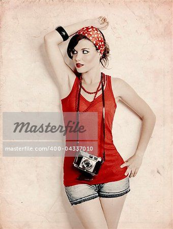 Stock photo of Portrait of a beautiful and stylish young woman with a retro camera; Royalty-Free, 400-04337010 © iko / Masterfile. All rights reserved.