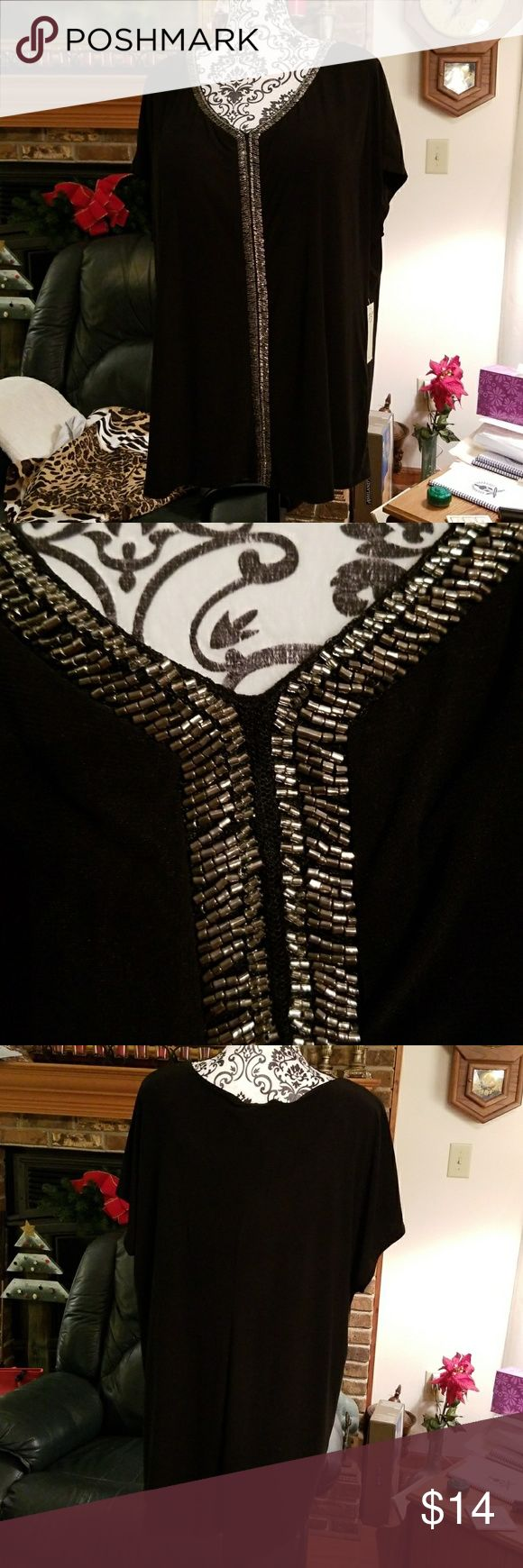 Black blouse NWT. PerSeption Woman black blouse. Trim is crusted with silver bugle beads. Short, slightly butterfly sleeves. Can go from office to night. PerSeption Woman Tops Blouses