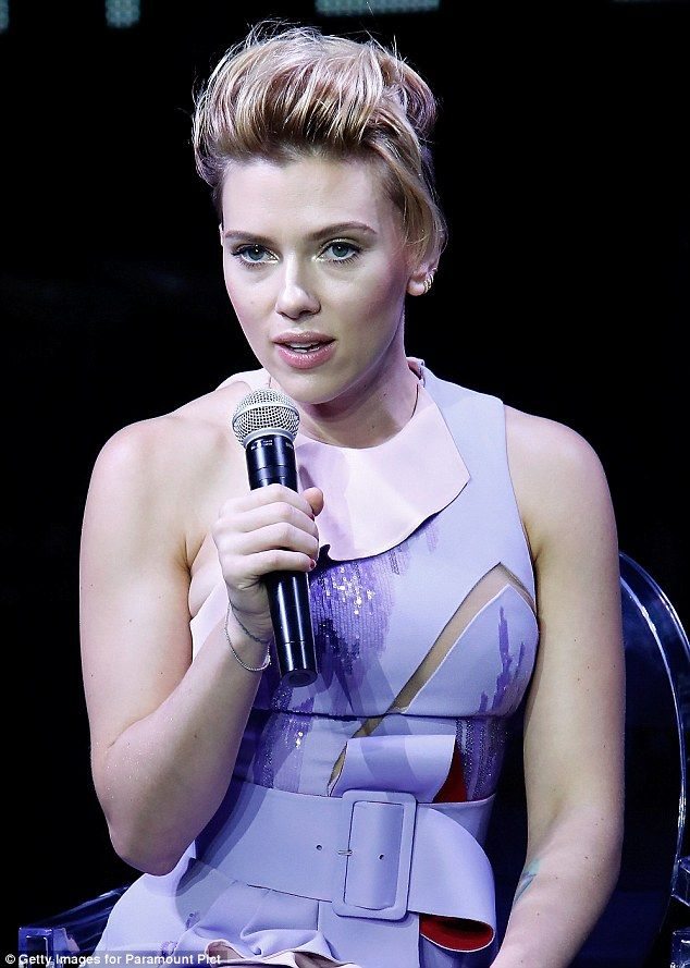 Womanly curves: Scarlett showed off her stunning figure in the sleeveless frock on Sunday...
