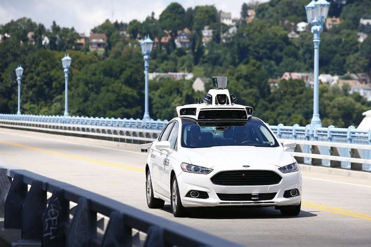 High-tech Uber vehicles back in SF — this time for mapping // FILE - In this Thursday, Aug. 18, 2016, file photo, Uber employees test a self-driving Ford Fusion hybrid car, in Pittsburgh. After taking millions of factory jobs, robots could be coming for a new class of worker: people who drive for a living.