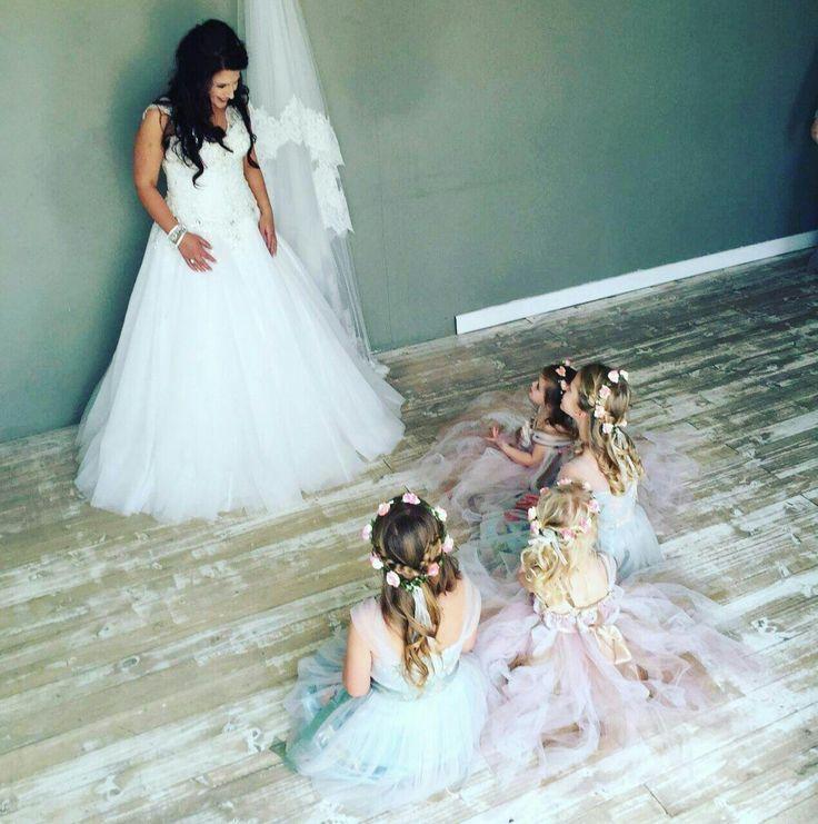 flower girls admire bride