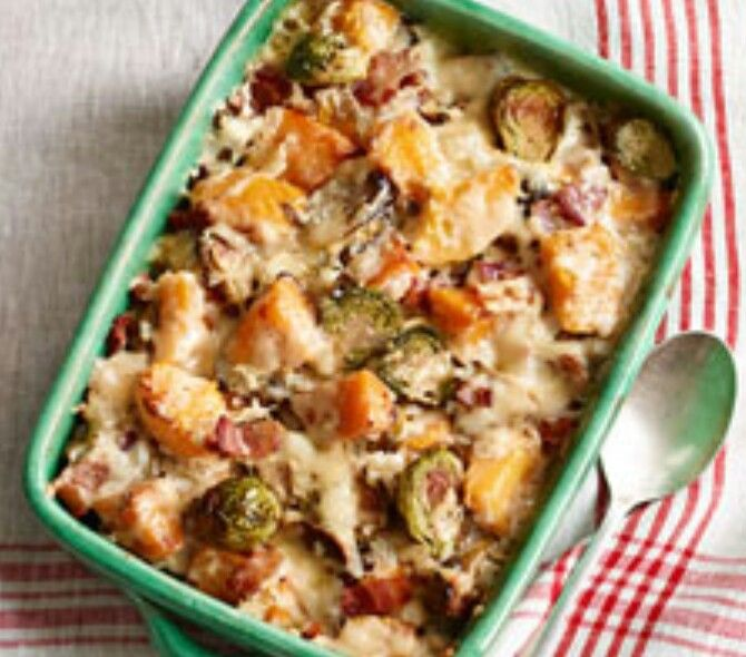 Bacon, Brussel Sprouts and Squash Gratin   -1 lb. Brussels sprouts, trimmed, cut in half   - 4 cups cut-up butternut squash (3/4-inch chunks)  - 2 Tbsp. olive oil 6 slices OSCAR MAYER Bacon, cut into 1/2-inch pieces  - 1 small onion, finely chopped  - 1/2 cup (1/2 of 8-oz. tub) PHILADELPHIA Chive & Onion Cream Cheese Spread - 1 cup fat-free reduced-sodium chicken broth  - 1 cup KRAFT Shredded Italian Five Cheese with a TOUCH OF PHILADELPHIA   ***Make It***  Heat oven to 425ºF. Toss Brussels…
