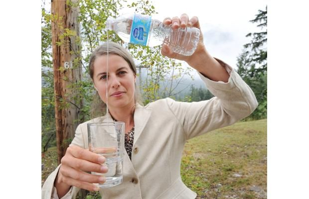 HOPE, BC -- August  12,  2013 --  Sheila Muxlow has concerns about Nestle withdrawing millions of litres of water without payment, outside Nestle's bottling plant near Hope on August 12, 2013.