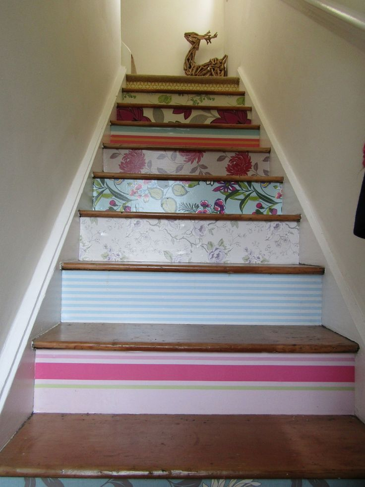 Stair uprisers covered in free wallpaper samples and sealed with copious coats of varnish
