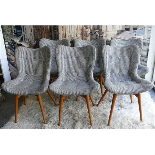 I love these re-covered retro dining chairs
