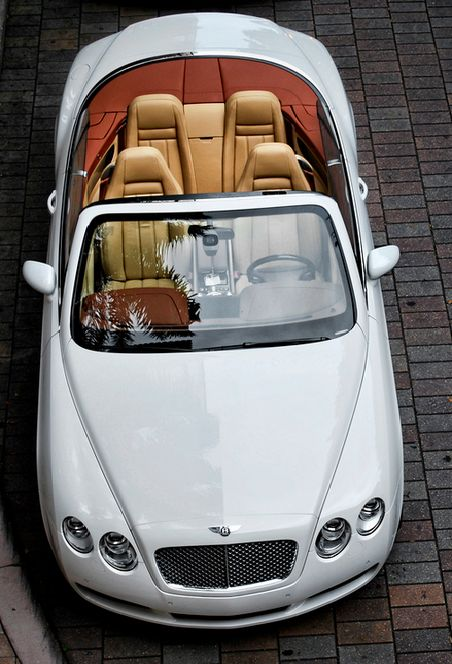 Bentley Continental GTC in White. perfect for the summer evening.
