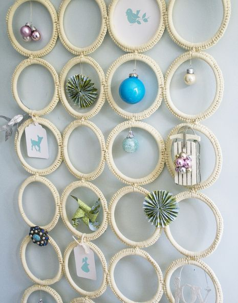 """Here is an interesting DIY Christmas charm - thinking it could be used for jewelry too... """"holder made by a nationally known holiday style expert Matthew Mead. It's perfect to display mini ornaments and looks quite modern. The holder is made of scarf hanger from IKEA so it won't cost you much."""""""