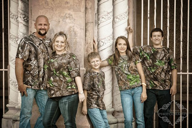 I gotta do this for our next family picture! Or, parents in reflective/hunting orange shirts, kids in camo.
