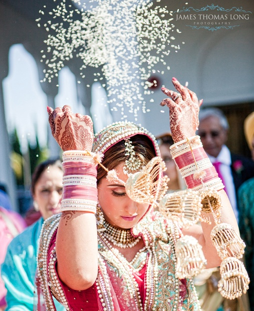 Indian Wedding Ritual A Throws Back The Rice Grains Backwards While Her Bidhaai And