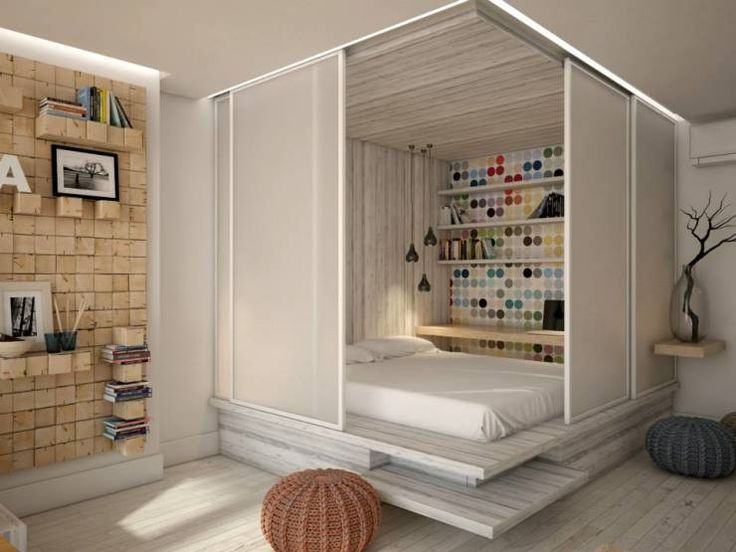 How to divide your rooms without walls? Great example here of a bedroom inside the living room by YOUR PROJECT.