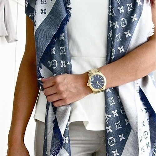 Louis Vuitton scarf... In Gold? Or just a neutral color!