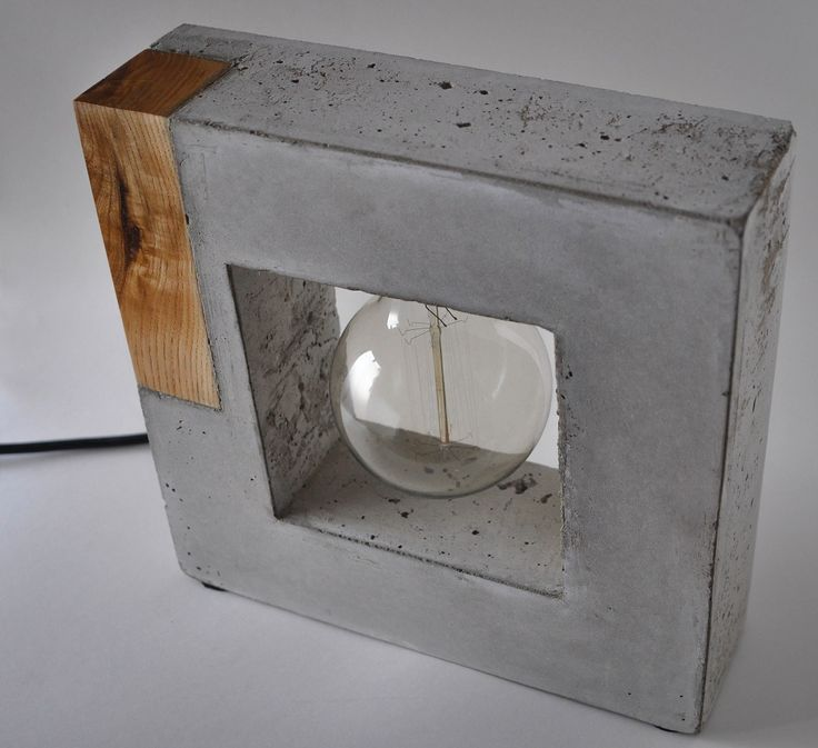 Handmade concrete and wood lamp by Curly woods artisant.