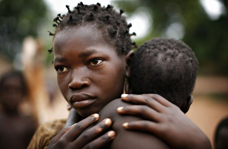Ano Mboligikpelani, 12, holds her sister, Honrine Ngbadulezele, 2, in the village of Bangadi in northeastern Congo, February 19, 2009. Thousands of Congolese have fled their villages since December as Ugandan Lord's Resistance Army rebels roaming the bush carry out massacres that have killed some 900 civilians in northeastern Congo during the past two months.