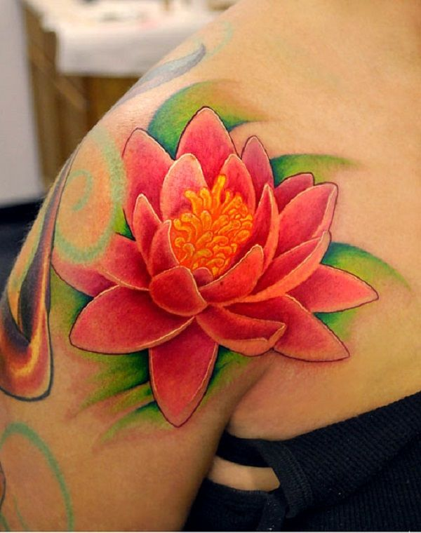 A bright pink lotus flower tattoo. The full and bright colors of the tattoo give life to the lotus flower thus making it look twice as blossomed as it already is.