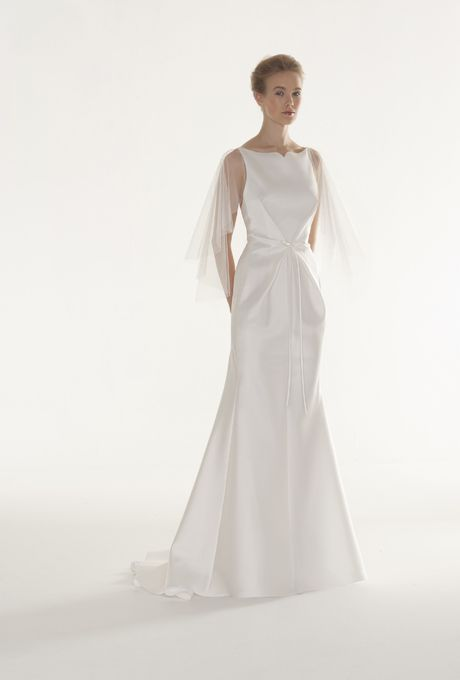 """Brides.com: . """"Balance"""" satin mermaid wedding dress with a bateau neckline, gentle tie under the bust, and an illusion tulle cape, Peter Langner  See more Peter Langner wedding dresses in our gallery."""