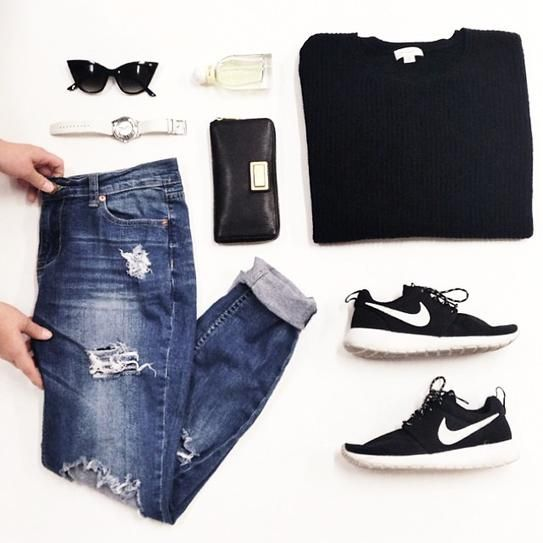 distressed cuffed denim + black sweater + black and white Nikes