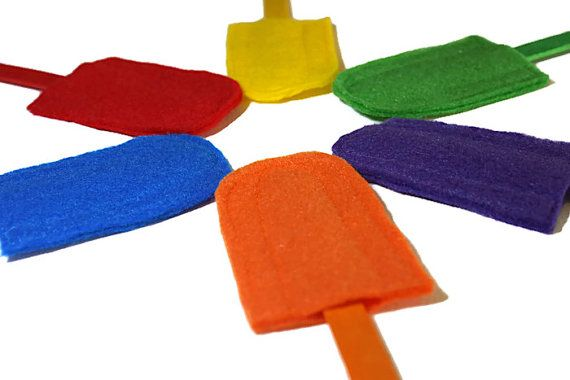 These bright and colourful felt popsicles are perfect for your little one to practice their colours and motor skills. Each opening at the bottom of the popsicle is approximately double the width of the popsicle stick, encouraging your child to concentrate to line up the popsicle stick with the opening but not too difficult to cause frustration.  Lay them out and play a colour matching game with your young child or keep them in their busy bag or quiet time bin for them to enjoy a quiet…