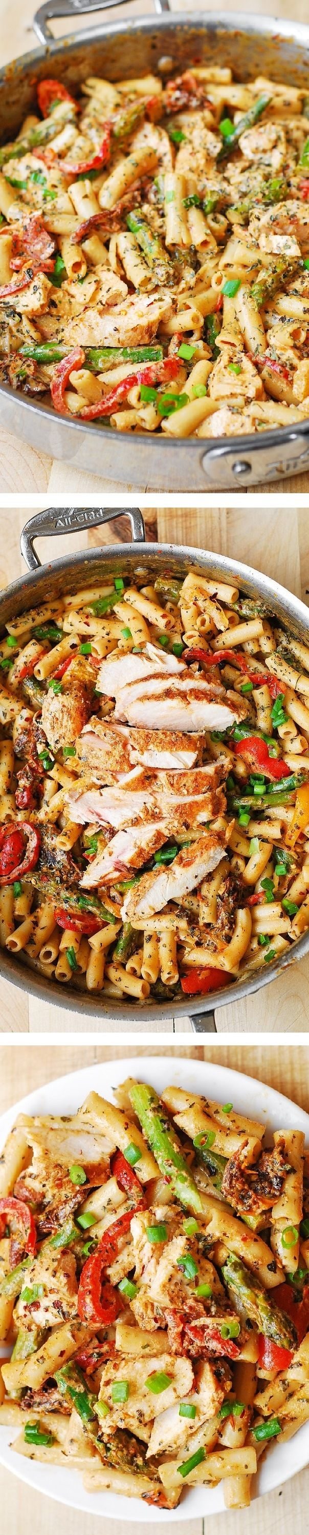 Chicken Alfredo Pasta with Bell Peppers, Asparagus, in a Creamy Sun-Dried Tomato Sauce.