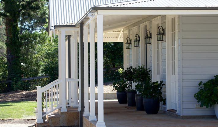 The Smith Home. Particularly love the lights and the simple veranda posts.