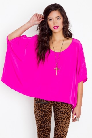 Major Drape Top  $48.00    Oversized silky fuchsia top featuring ultra-drapey sides and asymmetric hem. Looks perfect paired with skinnies and stacked bracelets!