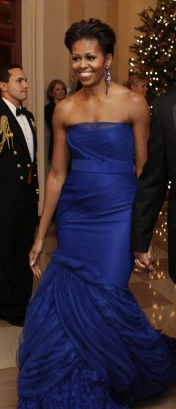 Michelle Obama is gracious, intelligent, poised. Role model, pioneer, mother, wife, lawyer and fashionista.
