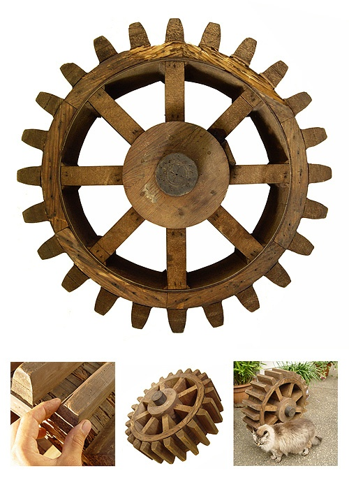 """""""Antique foundry pattern of St. Nicholas roll gear""""  Material: Wood   Dimensions: D=1130 mm  Note: The sign on a gear says """"Roll Gear - 39"""" P.D. 19T. 6449"""" C.P. St. Nicholas Sketch # SK-25-109."""""""