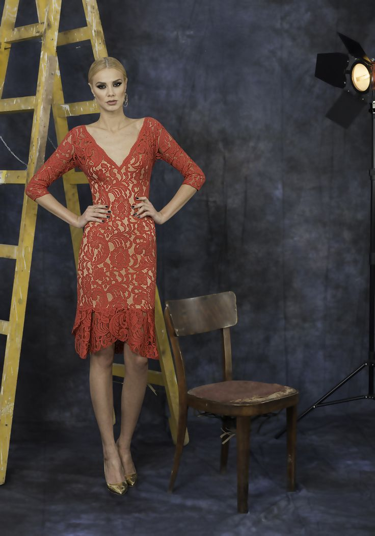 Red lace dress with nude lining and asymmetrical ruffles.