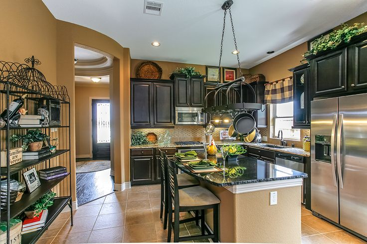 Gehan homes kitchen yellow wall color stainless steel for Kitchen cabinets houston tx