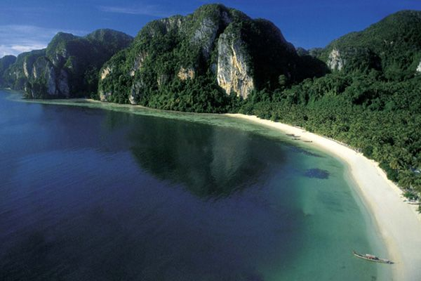 Tonsai Beach in Krabi is a popular spot with backpackers and rock climbers offering affordable accommodation and great climbing routes amongst the limestone cliffs and swimming.