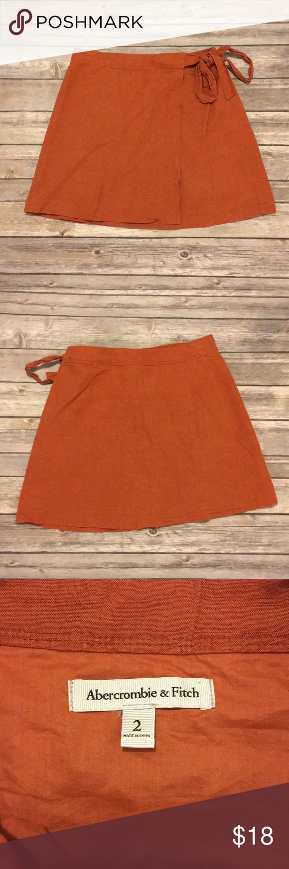 Burnt orange Abercrombie and Fitch wrap skirt Size 2. In excellent used condition. The button on the inside of skirt is hanging on by a thread but is totally fixable Abercrombie & Fitch Skirts