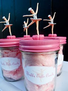 Ballerina party favors:  cotton candy in a jar topped with a figurine.  Could change it to match winter onederland and have a snowflake on top. @Amy Galan