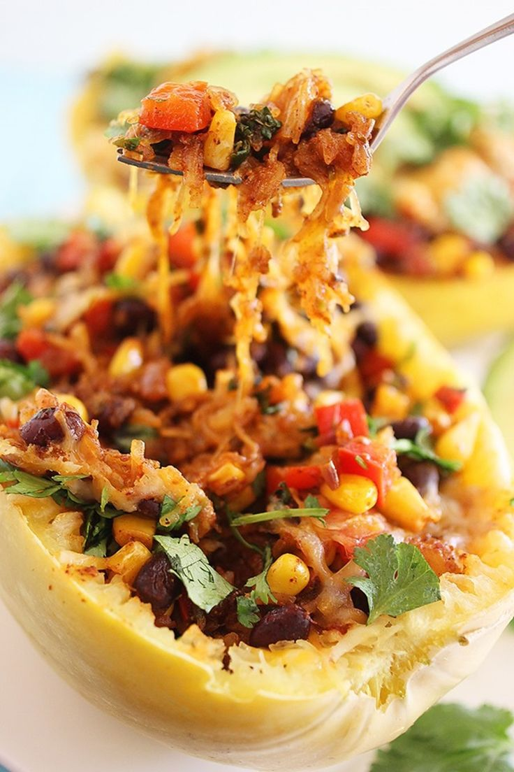 Southwestern Stuffed Spaghetti Squash Recipe ~ This hearty, healthy spaghetti squash stuffed with zesty Mexican flavors is perfect for putting a twist on your typical weeknight meals!