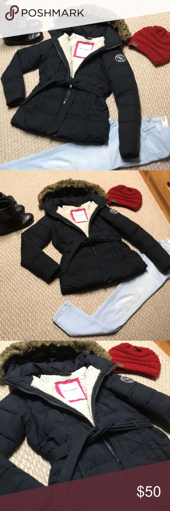 Abercrombie and Fitch puffer Gorgeous, gently used girls a&f navy blue puffer coat. Ties at the waist, stops mid tush. Extremely soft material, with vegan fur inside and lined hood. Girls xl (size 12-14) true to size. Was worn only a dozen times by my daughter last winter and this winter she had a huge growth spurt, outgrowing everything. No stains or flaws of any kind. No pilling, no signs of wear. Abercrombie & Fitch Jackets & Coats Puffers
