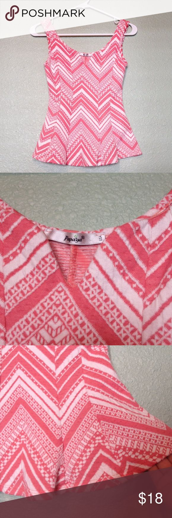Papaya Pink Peplum Top wit Aztec Pattern Adorable pink peplum top by Papaya. Chevron Aztec pattern is so flattering! Pair with jeans and leather jacket! Papaya Tops Blouses