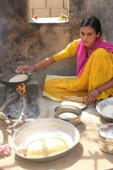 The Chapati Hotti. This young lady in an Indian vilage was so incredibly beautiful but she simply had no idea about it and would probably prefer to be noted for the flatbreads she was so aptly making. Photo by K Peterman.