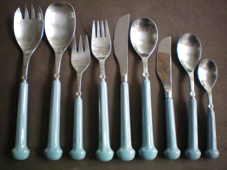 """Blue stoneware handled flatware / cutlery like ours, (although this image color is slightly off) which matches our original """"everyday"""" dishes from 1980, which we still use. Denby 'Castile' is the name of the blue version of these dishes and the flatware. The shape of these dishes also come in other colors, each of which has a different pattern name. A soft green, soft sable brown, off-white, burgundy, plus a green and an off-white both with tiny flower sprigs."""