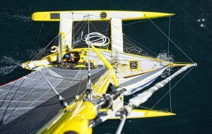 Beached abandoned mid-ocean capsized Acapella the invincible little yellow trimaran